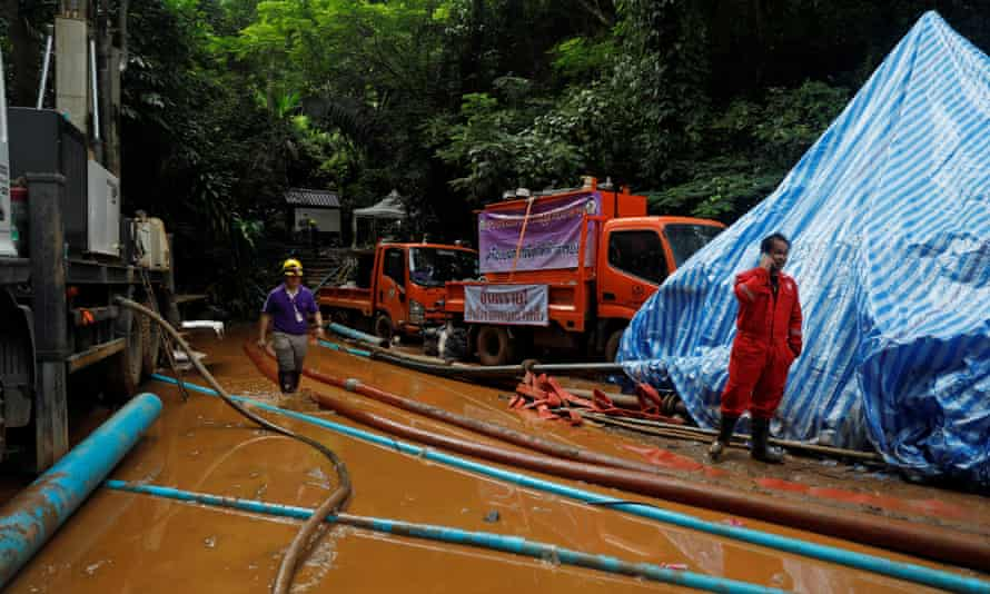 Rescue workers exit the Tham Luang Nang Non cave complex