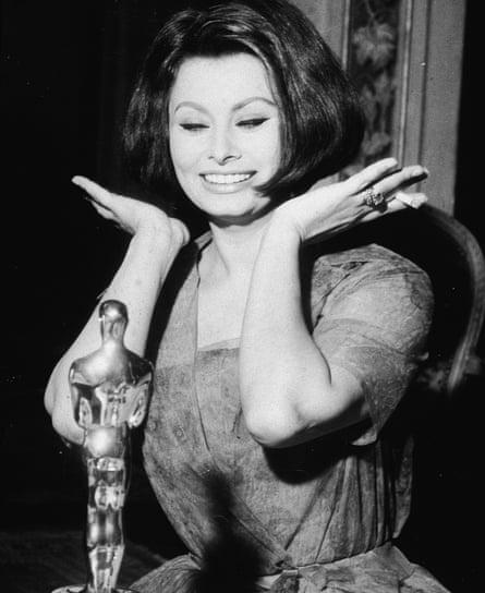 Sophia Loren with the best actress Oscar she won in 1962
