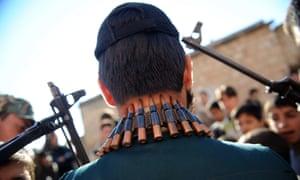Free Syrian Army fighters stand guard in Idlib, northwestern Syria
