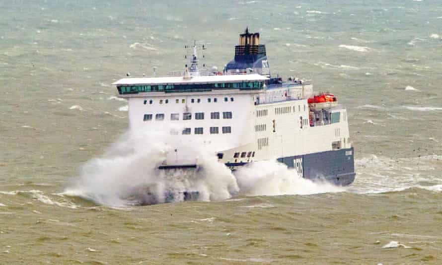 The ferry Cote Des Flandres ploughs through stormy seas into Dover harbour on its from Calais