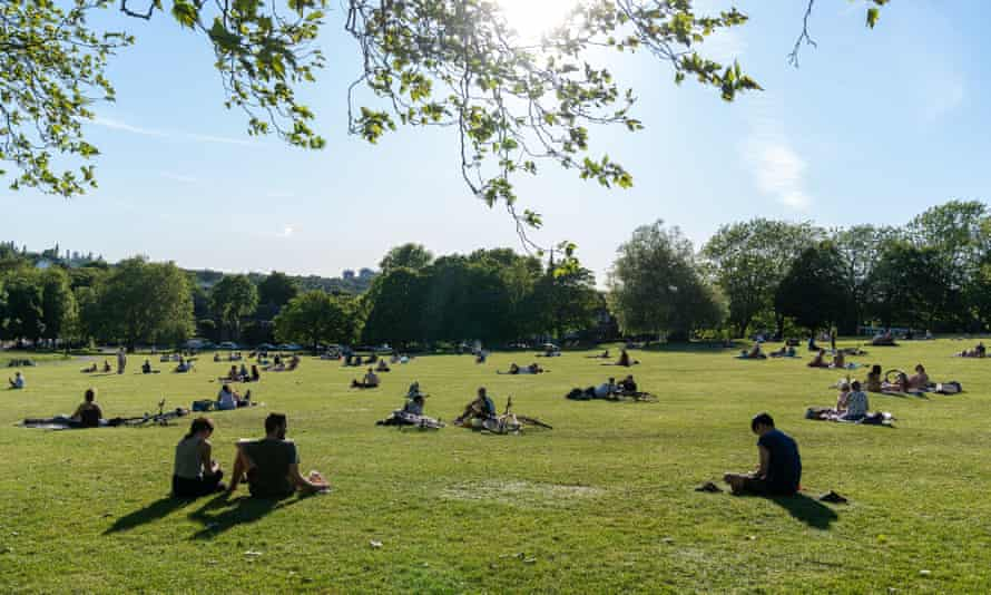 People maintaining physical distance in Hilly Fields park, London.