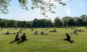 People sitting in a park in London