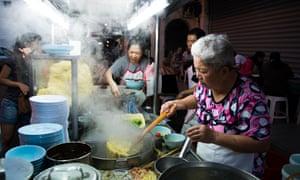 Street food stalls at the vibrant night market in Penang.