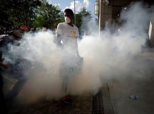 Raleigh, North Carolina. A protester is simultaneously pepper sprayed and tear gassed during protests on Saturday