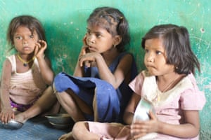 Children wait for food at a care centre in Khoch, in the west Indian state of Maharashtra