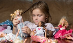 Playing with her Barbie dolls