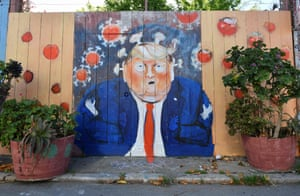 San Francisco, US A painted fence depicts President Trump as the coronavirus