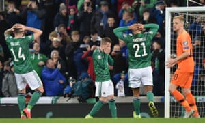 Steven Davis, centre, reacts after putting his first-half penalty high over the crossbar.