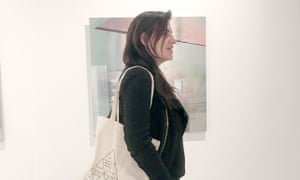 Justine Frischmann with one of her paintings in the background.