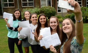 (From left) Twins Martha and Clara Finn, Lydia and Eleanor Tsoukkas and Phoebe and Rosanna Codrington take a selfie while they hold their GCSE results at Putney high school in west London.