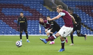 Burnley's Chris Wood shoots and scores the opening goal of the game from the penalty spot.