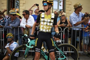 George Bennett wears a special plastic bib with several pockets filled with ice due to a heat wave in France, as he waits for the start of the seventeenth stage.