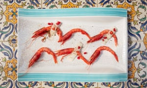 Uncooked red prawns with melon, chili pepper and pomegranate