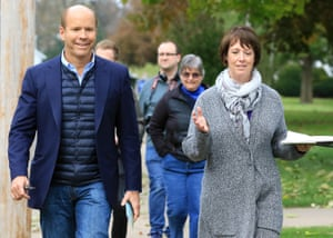 Delaney canvasses a neighborhood in Clinton, Iowa in October.