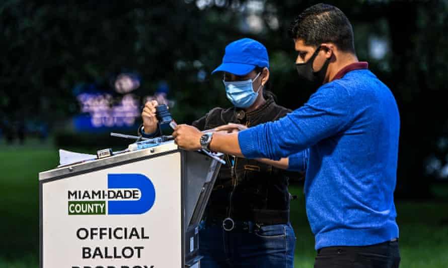 People at a ballot drop box in Miami-Dade county, florida