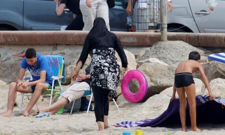 A Muslim woman in a burkini on a beach in Marseille.