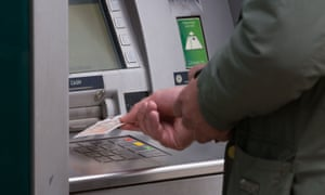 A man removing money from an ATM