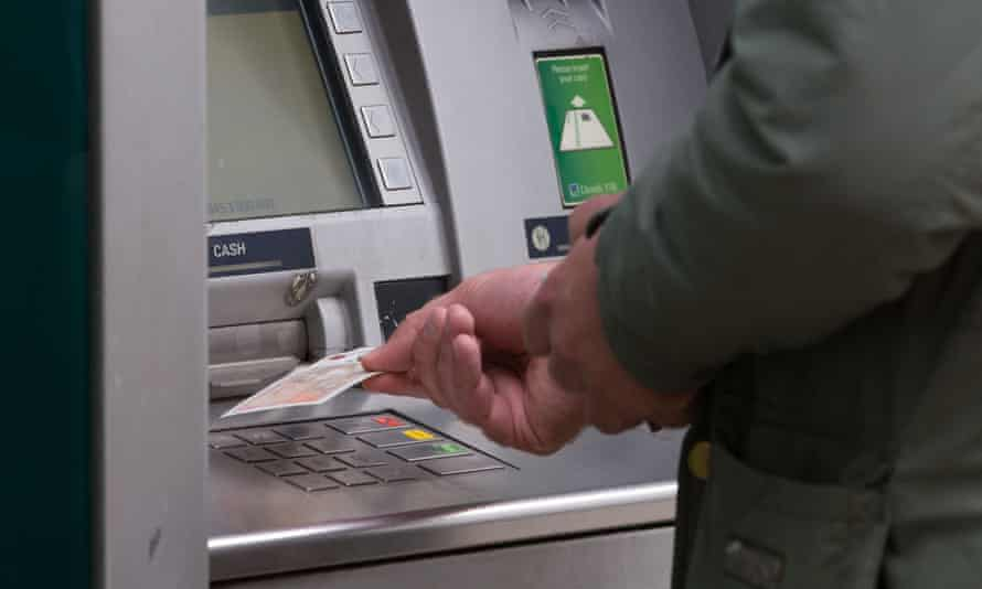 A man withdrawing money from a cash machine