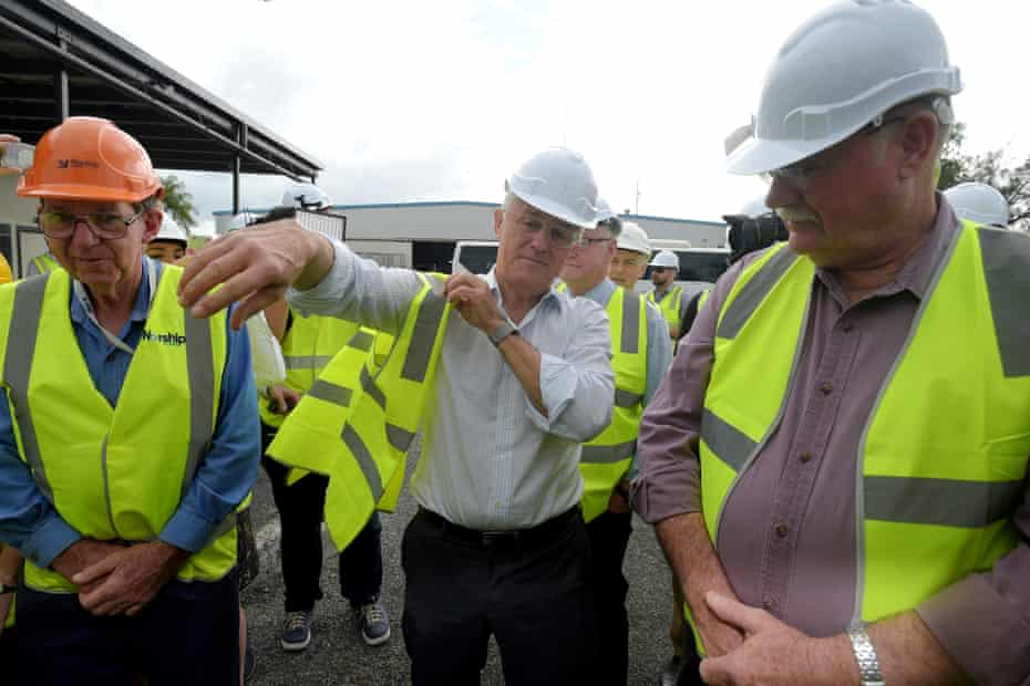 Malcolm Turnbull puts on a high vis vest as he takes a tour of the Norship Marine shipyards in Cairns on Wednesday.