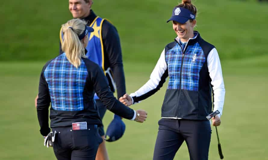 Europe's Anne van Dam (right) and Suzann Pettersen embrace after winning their fourball.