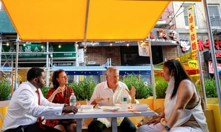 New York City Mayor Bill de Blasio has lunch with staff members outside the Wo Hop restaurant in Chinatown.