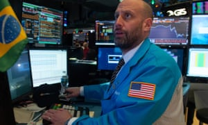 Traders work on the floor at the closing bell of the Dow Industrial Average at the New York Stock Exchange on 19 December in New York.