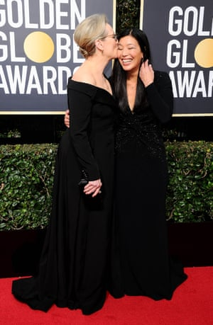 """Meryl Streep arrives Ai-jen Poo, the director of the National Domestic Workers Alliance and co-director of the Caring Across Generations Campaign. She and I are so happy to be here in this particular moment,"""" she told E! News on the red carpet. """"I think that people are aware now of a power imbalance and it's something that leads to abuse."""""""