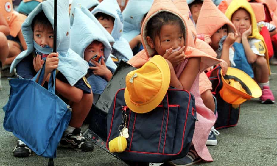 Children take part in a disaster drill at an elementary school in Tokyo