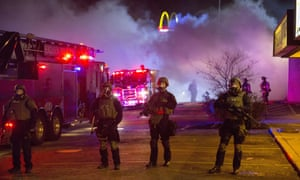 Police stand guard during rioting in Ferguso