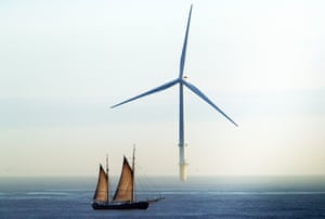 Whitley Bay, England. The William II tall ship passes a wind turbine as it sails on a voyage round the coastline of Great Britain