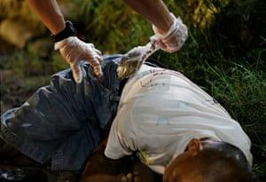 An officer removes a bag of marijuana