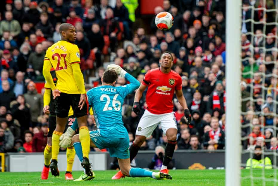 Anthony Martial chips home United's second.
