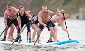 A stand-up-paddleboard race at Tribal Clash
