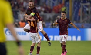 Alessandro Florenzi is congratulated after his wonder strike puts AS Roma back on level terms.
