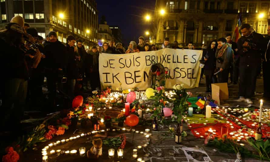 Members of the public gather at the Place de la Bourse in Brussels to leave messages and tributes.