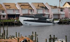 Damaged boats and houses in a marina at Treasure Cay.