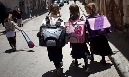 Jewish girls walk home from school in Jerusalem. Critics of the law say it could be used to block anyone who criticises Israel to a foreign entity from speaking in schools.