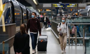 Travellers disembark in London from the Eurostar from Paris. From 4am BST today, the UK changed its 'traffic light' meaning that fully vaccinated arrivals from France do not need to quarantine.