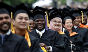 Students at college graduation