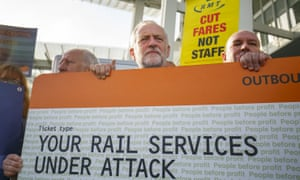 Labour party leader Jeremy Corbyn, centre, joins rail trade union representatives to protest against fare increases and to call for the railways to be re-nationalised