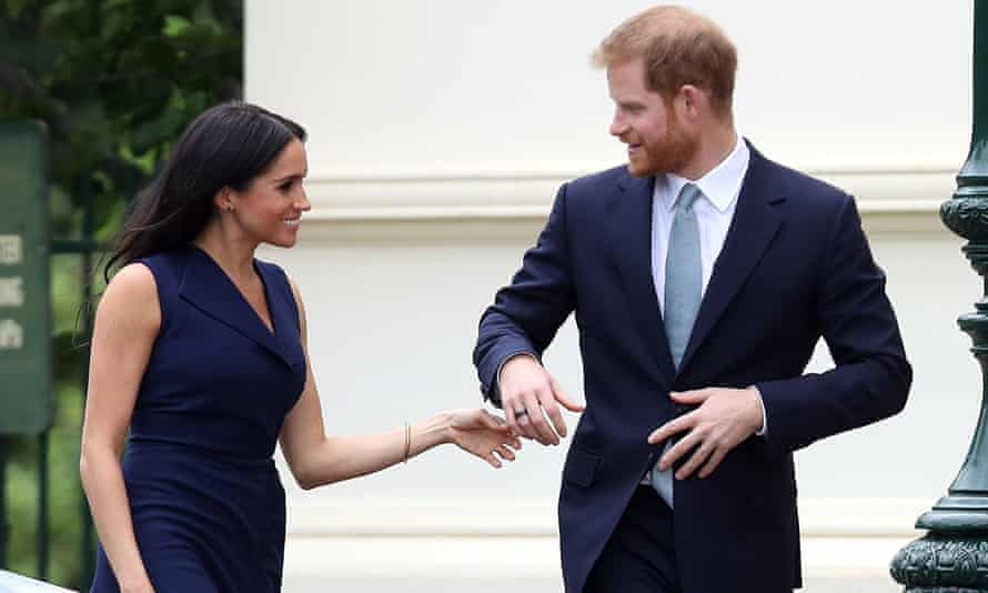 Prince Harry and Meghan arrive for a reception at Government House.