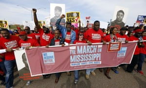 Auto workers and others march to Nissan's Canton, Mississippi, plant following a pro-union rally in March.