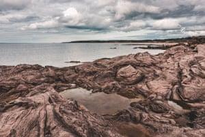 Laminated sandstones on Gullane beach, east coast of Scotland by Milena Farajewicz.