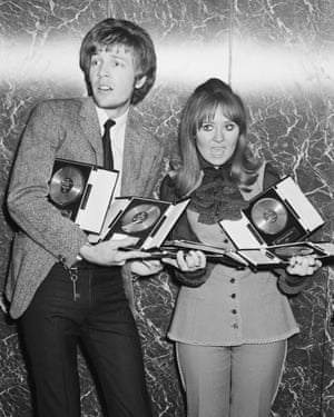 Lulu and Walker hold their awards from the St Valentine's Day Presentation party, 14 February 1968.