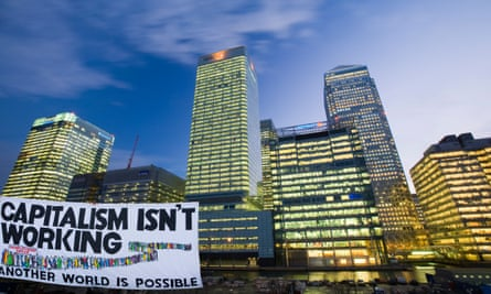An anticapitalist protest banner in front of financial sector offices at Canary Wharf, London