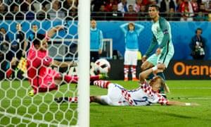 Daniel Subasic saves Cristiano Ronaldo's shot.