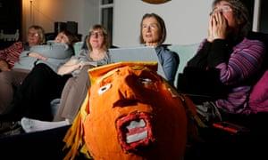 Scottish anti-Trump campaigners and Trump piñata in the foreground