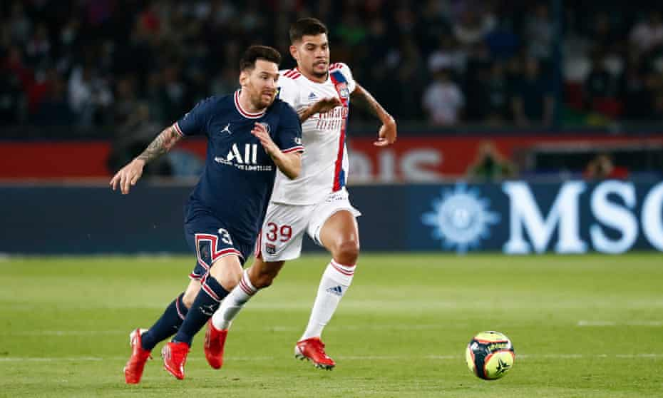 Lionel Messi is challenged for the ball by Bruno Guimarães during PSG's narrow win over Lyon.