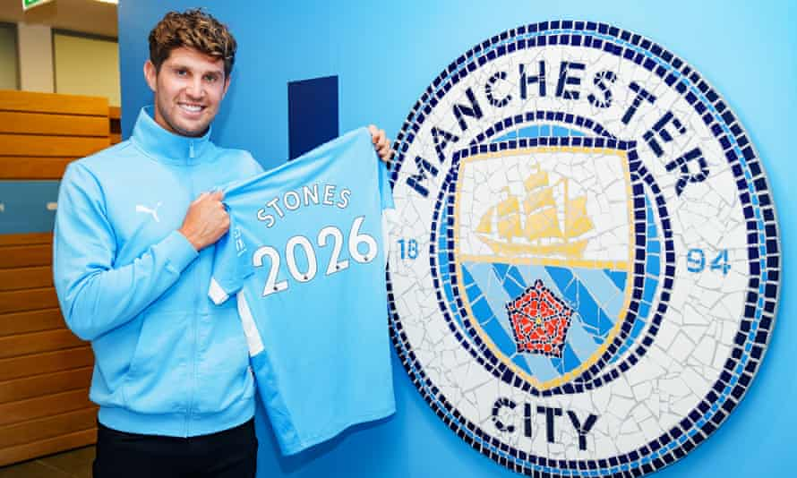 John Stones celebrates his Manchester City contract extension. 'I love being part of this squad,' he said.