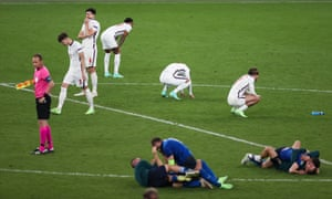 England players dejected as Italy team celebrate winning the penalty shootout.
